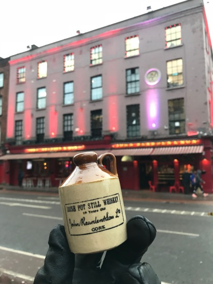 A Reardens Whisky crock with the pub in the background